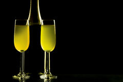 Glasses and bottle of champagne isolated on a black background. Bottle of wine with the glass on the black background Royalty Free Stock Photo