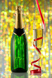 Glasses and bottle of champagne, serpentine Royalty Free Stock Photos