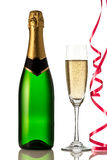 Glasses and bottle of champagne, serpentine isolated on a white background. Royalty Free Stock Photos