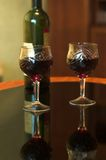 Glasses and bottle of wine. Bottle of Red Wine and Two Glasses with Reflection Royalty Free Stock Photo