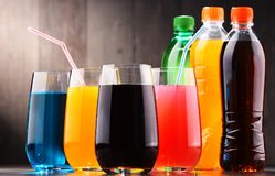 Glasses and bottles of assorted carbonated soft drinks. In variety of colors stock photography