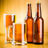 Glasses and bottles of beer. On the wooden background Stock Photo