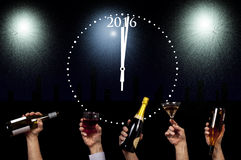 Glasses and bottles being raised for new year 2016 royalty free stock photos