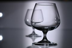 Glasses and bottles for brandy and wine. In the background royalty free stock photo