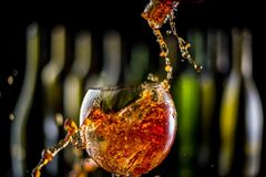 Glasses and bottles for brandy and wine. In the background royalty free stock photography