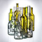 Glasses and bottles for brandy and wine. In the background royalty free stock images