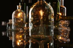 Glasses and bottles for brandy and wine. In the background stock image