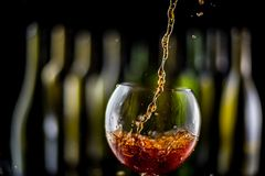 Glasses and bottles for brandy and wine. In the background stock photography