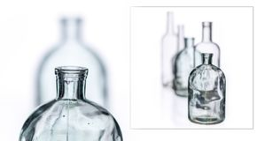 Glasses and bottles for brandy and wine. In the background royalty free stock photos