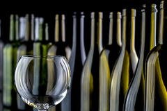 Glasses and bottles for brandy and wine. In the background royalty free stock image