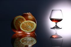 Glasses and bottles for brandy and wine. In the background stock photo