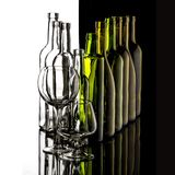 Glasses and bottles for brandy and wine. In the background stock photos