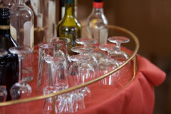 Glasses And Bottles Displayed On Restaurant Table Stock Photography