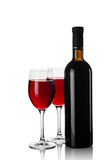 Glasses and bottles of red wine Stock Images
