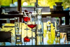 Glasses and Bottles on the Table stock photography