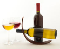 Glasses and bottles of wine unusually on white Royalty Free Stock Image