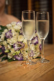 Glasses and bouquet. Royalty Free Stock Image