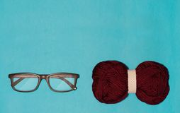 Glasses and bow lie on a blue background, grandfather`s and grandmother`s bow royalty free stock images