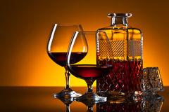 Glasses of brandy on the reflective background Royalty Free Stock Photography