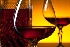 Glasses of brandy on the reflective background Royalty Free Stock Photo