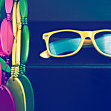 Glasses and brightly colored beads Royalty Free Stock Photo