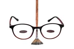 Glasses and brushes isolated on white background, close-up. royalty free stock photos
