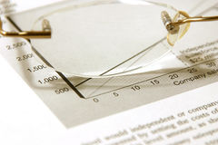 Glasses and the Budget. Reports Royalty Free Stock Photo