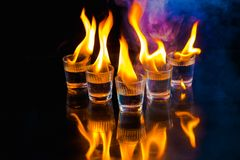 Glasses with burning alcohol on black background. Glasses with burning alcohol on  black background Stock Photography