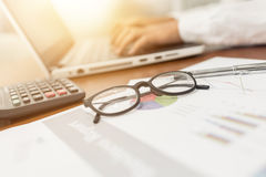Glasses on business document Stock Photos
