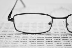 Glasses on business graph, financial concept Stock Image