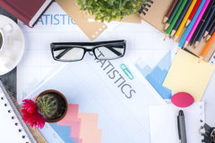 Glasses on business report Stock Image