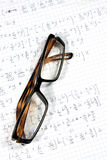 Glasses and calculations Royalty Free Stock Image