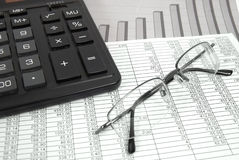 Glasses and calculator Royalty Free Stock Photo