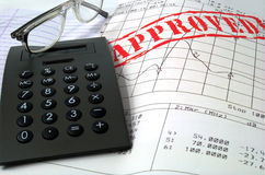 Glasses  calculator in approved doc Stock Photo