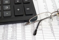 Glasses and calculator Stock Photography