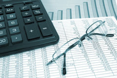 Glasses and calculator Stock Images