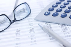Glasses and calculator Royalty Free Stock Images