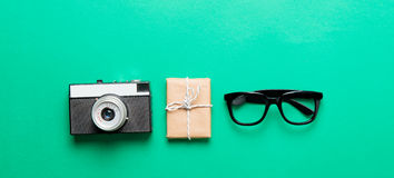 Glasses, camera and gift Stock Images