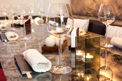 Glasses, candle on table in sushi restaurant Stock Images