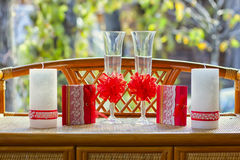 Glasses with candles on the table. Glasses with candles and cards are on the table Royalty Free Stock Images