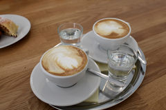 Glasses of cappuccino and water Royalty Free Stock Photo