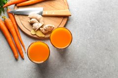 Glasses of carrot juice. On light table royalty free stock photo