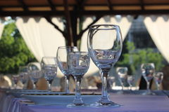 Glasses on celebration table waiting guests Royalty Free Stock Photography