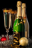 Glasses of champagne. With bottles and christmas balls Royalty Free Stock Image