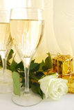 Glasses of champagne. Two glasses of champagne with white rose and gift royalty free stock photo