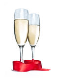 Glasses with Champagne. And red ribbon isolated on white background Stock Images