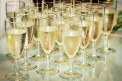 Glasses with champagne. On the party table Royalty Free Stock Image