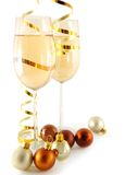 Glasses with champagne. Two glasses with champagne and christmas ball near stock photography