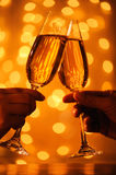 Glasses with champagne. In female and male hands Stock Image