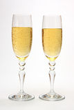Glasses with champagne. Glasses on a high leg with champagne Royalty Free Stock Photography